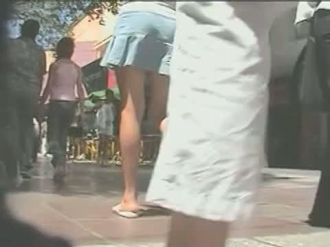 Voyeur street candid upskirt video footage of sexy legs