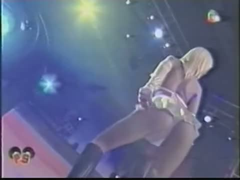 A bimbo blonde dances during a tasteless live concert