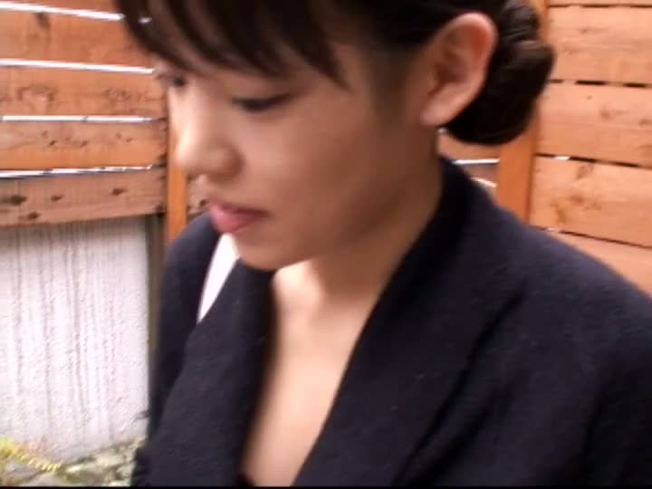 Asian business lady lets a downblouse voyeur peek in