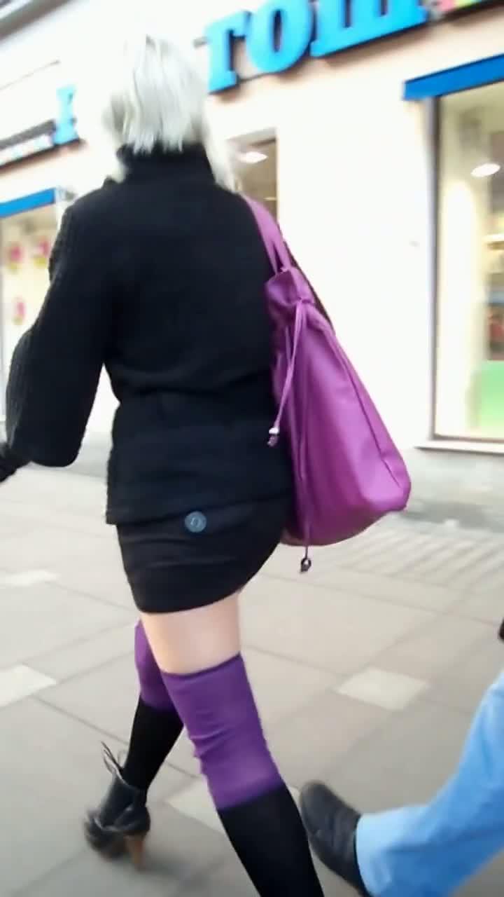 Slutty blonde in sexy stockings followed by an upskirt voyeur