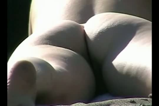 XXX sunny nudist beach porno of a pleasant white ass jiggling